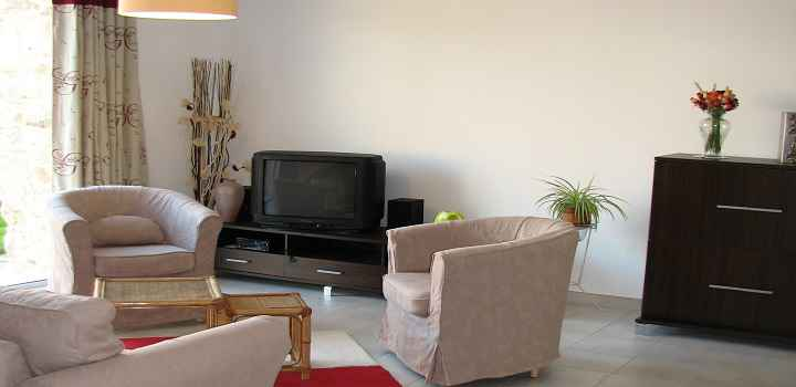 Self catering cottages France tv and armchairs